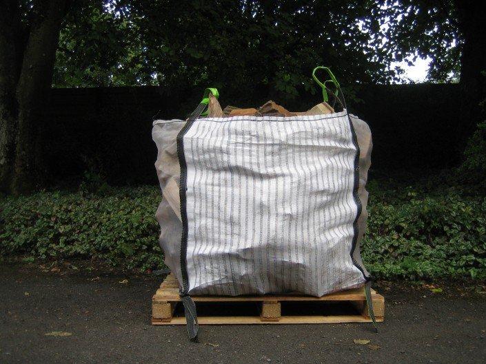 Single bag of Kiln Dried Bulk Firewood on pallett
